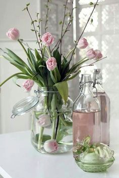 Pink flowers in glass milk bottles (from The Simply Elegant Kitchen FB page)