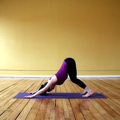 This easy version of Downward Facing Dog allows you to target the back more than the hamstrings. Come onto your hands and feet in Downward Facing Dog. Bend your knees, lift your heels off the mat, and allow your spine to arch, pressing your navel