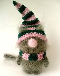 This amigurumi kitten made of fuzzy grey mohair. He wears nice pink and green removable hat and scarf. Hat and scarf are made of fabulous natural woolen yarn! The hat and scarf can be swapped with other characters. He is stuffed with non-allergic holofiber. Kitten will arrive to you packed in a a custom brown bag.  Нe is about 12 cm tall =4,7 inches  PLEASE NOTE, TOY IS NOT SUITABLE FOR SMALL CHILDREN. RECOMMENDED AGE 5+