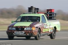 Pick-me-up truck: The world's only coffee powered car, commissioned by The Co-operative Food, has broken the Guinness World Land Speed Record for a vehicle powered by coffee chaff