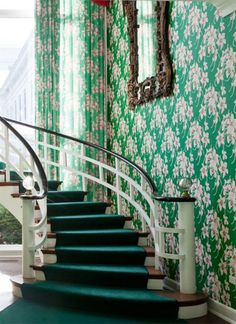 Plah the wallpaper, but that balustrade! In brass and ebony, naturally.