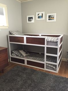 IKEA kura bed hack. Spray painted white and replaced blue pieces with particle board from Home Depot that I then stained. Husband cut extra pieces and put together. Pretty cool looking bed that goes well with the mid century modern decor of the boys room and our house. Bed was given to us and the extra materials cost around $70. Say whaaaaa?
