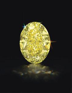 An Oval-Cut Fancy Intense Yellow diamond, internally flawless, 68.35 cts.