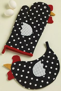 Dotty Hen Oven Mitt, by DII. The Home to Roost Collection features a whimsical theme of chickens in a red, black, cream, and white color palette. This is for the Oven Mitt, which is black with white polka dots and has sewn fabric chicken features (this is the item on the TOP in photo). Measures 7 x 11 inches. 100% cotton. Other items in collection a...