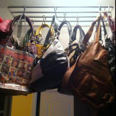 Purse organization in small closet. LOVE it!