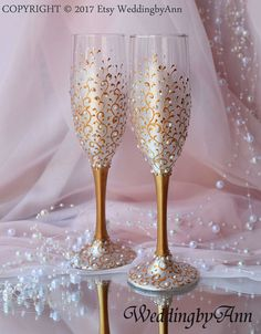 Listing for glasses, set of 2 Very Gentle White and Gold Wedding glasses with beautiful pearl paint, decorated with gold scrolls , pearls and crystals. They look very gently in reality and crystals gives beautiful shine! They are classic gold and white and will be a perfect decoration