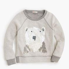 A polar bear covered in special square-shaped sequins puts this comfy fleece sweatshirt at the very top of her holiday wish list. <ul><li>Cotton.</li><li>Long sleeves.</li><li>Machine wash.</li><li>Import.</li></ul>
