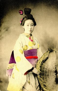 Japan. Tokyo Geisha holding a Torioi Amigasa hat, 1905