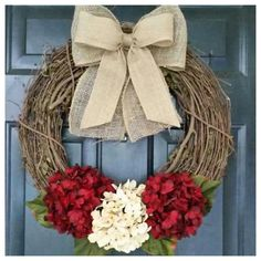 This deep red and creamy white hydrangea wreath with a double burlap bow is simple, yet classic .... just perfect to hang on your door for the