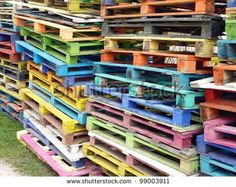 Piles of colorful wooden pallets - Shutterstock