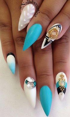 Turquoise blue matte stiletto shaped rhinestone nails @nailsbymztina