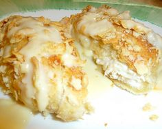chicken pillows. Nice stuffed bun idea.   INGREDIENTS     Print This Recipe  1 (8 oz) can Pillsbury Crescent Rolls  8 oz cream cheese  1/4 cup butter  2-3 cups cooked and shredded chicken  1 egg  1 sleeve Saltine Crackers crushed  1 can cream of chicken soup  1/4 cup milk  2 spoons full sour cream  1/2 cup shredded cheese