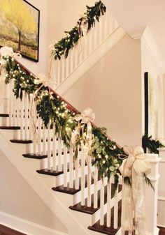 Parade of Homes Nashville Area natural garland, white lights, gold bows draped on handrail of staircase.natural garland, white lights, gold bows draped on handrail of staircase. Christmas Time Is Here, Noel Christmas, Winter Christmas, Vintage Christmas, Outdoor Christmas, Office Christmas, Elegant Christmas, Natural Christmas Tree, Whoville Christmas