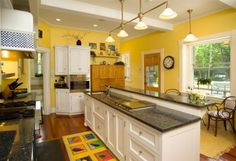Fresh Cheerful Yellow kitchen Wall with White Cabinets