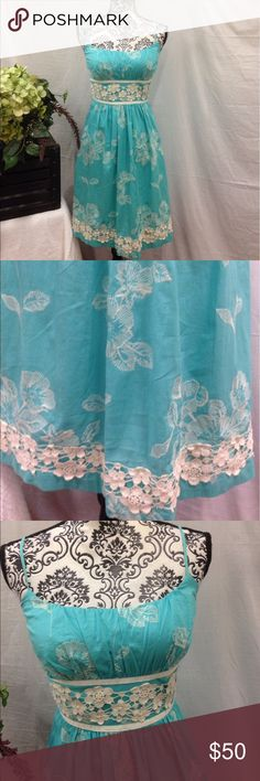B. Darlin Aqua Embroidered Flare Dress Size 9/10. Fluffy lined skirt. Fitted Embroidered Bodice. Lace details. Ties in back. Aqua and cream. B darlin brand from Dillard's. B Darlin Dresses Midi