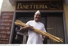 Italian baker with hand-made grissini, Barolo [290278]