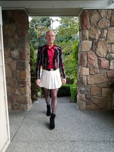 Wore to musical theater production in Seattle 10/1/2017. White pleated bcbg mini skirt, red satin silk shirt, bcbg crop jacket, black nylons, black chunk high heel shoes.