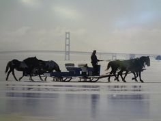Mackinac Bridge in winter. The ice bridge on Lake Huron to the island is solid. The island shuts down for the winter, so those who live their permanently have it hard.