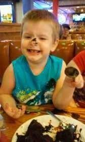 Eating his cake. Red Lobster. Sara, Christine, Brensa 6-2015