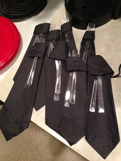 Folding napkins into neck ties...50 shades of grey party