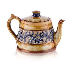 GEORGE TINWORTH (1843-1913) FOR DOULTON, LAMBETH STONEWARE TEAPOT AND COVER, CIRCA 1880
