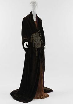 """Paul Poiret (French, 1879?1944)   """"Paris"""" Evening Coat Worn by Denise Poiret, 1919   Brown silk velvet with placket of red and blue wool and couched gilt-silver cording"""