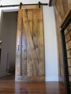 Sliding barn doors made from reclaimed wood. Use for bathroom door to replace that tight space in a small bath caused by standard doors? by greta