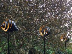 Metal bee sculptures seen at Hillier Gardens