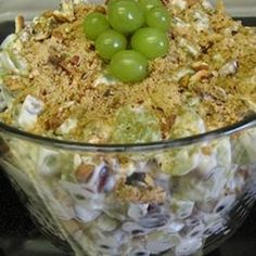 Grape Salad  Ingredients: 4 pounds seedless green grapes or 1/2 green & 1/2 red 1 (8 ounce) package cream cheese 1 (8 ounce) container sour cream 1/2 cup white sugar 1 teaspoon vanilla extract 4 ounces chopped pecans 2 tablespoons brown sugar  Directions: Wash and dry grapes. In a large bowl, mix together the cream cheese, sour cream, sugar and vanilla. Add grapes and mix until evenly incorporated. Sprinkle with brown sugar and pecans, mix again and refrigerate until serving.