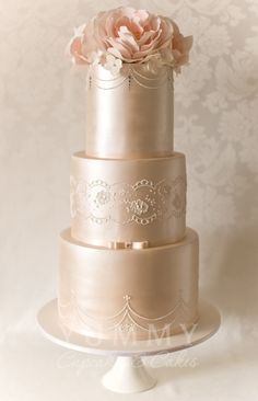 Gorgeous rose gold wedding cake with hand-tied bows and floral embellishments. Elegant Wedding Cakes, Elegant Cakes, Beautiful Wedding Cakes, Gorgeous Cakes, Wedding Cake Designs, Pretty Cakes, Amazing Cakes, Cake Wedding, Wedding Cakes With Cupcakes