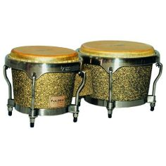 """Tycoon Percussion 7 Inch & 8 1/2 Inch Master Tour Series Bongos by Tycoon Percussion. $188.17. Tycoon Percussion's Master Tour Series Bongos are constructed of carefully selected aged Siam Oak with 7"""" & 8.5"""" water buffalo skin heads for rich bass tones and crisp highs.  Unique finishing procedures give these drums a unique look and a durable textured feel – ideal for the touring percussionist.  Their wide tuning range is perfect for live or studio use.  Bongo ..."""
