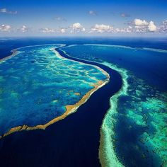 The #GreatBarrierReef from the air is an incredibly beautiful sight and it's easy to see why @tscharke describes seeing it as an experience that he'll never forget. In this image which was taken on a scenic helicopter flight you can see Hardy Reef on the left and Hook Reef on the right and to think that this is just a small snapshot of this enormous reef that stretches for 2300 kilometres! by australia http://ift.tt/1UokkV2