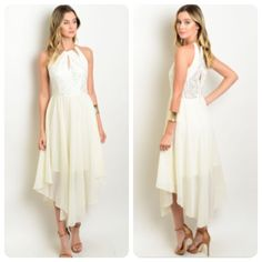 Ivory Asymmetrical Dress Gorgeous sleeveless gown with a lace bodice and a flowy chiffon skirt. The dress is lined to above the knees and has an asymmetrical hemline. It is made of 100% polyester. Ships this Wednesday. Boutique Dresses Asymmetrical