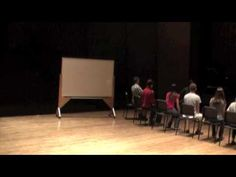 Video shows Dalcroze method for teaching pitch steps.  Incorporates whole body.