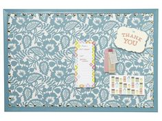 Cover a Bulletin Board With Floral Fabric - Take Basic Household Items From Boring to Brilliant on HGTV