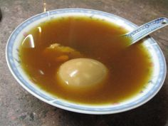 A bowl of nourishing Dong Quai soup with hard boiled egg * A Chinese prescription of herbs for women's reproductive system health, especially for treating menstruation symptoms and nourish bl…