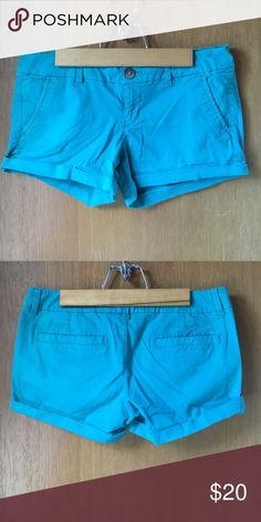 Turquoise khaki shorts Very comfortable shorts that are long enough for school when unrolled! American Eagle Outfitters Shorts
