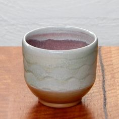 Wood fired copper glazed Yunomi - outer surface copper crystal formation, inner surface mauve-pink atmospheric reduction.  Dianne Collins, Melbourne