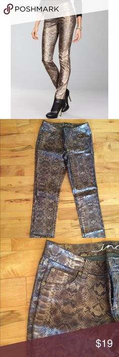 """🎉Sleek, Shiny, Sexy INC Snakeskin Denim, sz 8 🎉 EUC Jeans are size 8, lying flat 15"""" waist, 19"""" hip, 30"""" inseam. Worn once on NYE, got TONS of compliments! The material has some stretch. The gold tone shine in fabric varies with light, the brighter the light, the more intense the shine. I included close up out of direct light for accurate representation. Please see last photo, there is some variation in tone of fabric, on folds, this was present at purchase. Not noticeable when wearing…"""