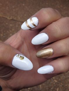 Long white oval nails with gold accents and a skull! My boredom got the best of me.
