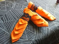 For Halloween table setting. Orange napkins and black lace rings