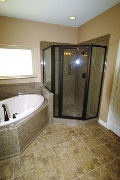 corner granite shower   Above: made-to-order cultured granite bathtub surrounds and shower.