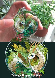 Terrarium dragon keychain by sandara on DeviantArt Acrylic Keychains, Acrylic Charms, Pokemon, Artist Alley, Magical Jewelry, Kawaii Accessories, Cute Dragons, Cute Keychain, Cute Pins