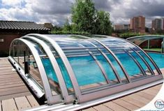 Keep your pool clean with glass cover. This thing is sweet, winter swimming!