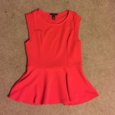 Red peplum top Red peplum top from forever 21. Never worn! Form fitting but has stretch in fabric Forever 21 Tops Tank Tops
