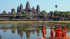 "Angkor Wat is a temple complex surrounded by a moat, built by Cambodian king Suryavarman II in the early 12th century to serve as the state temple and capital city. The symmetry and ""harmony"" of its design has been compared to the most famous architecture of ancient Greece and the Romans."