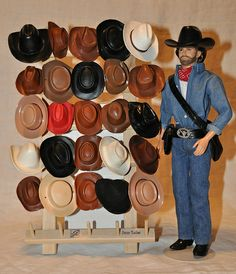 spool holder from Joann Fabrics store and various cowboy hats