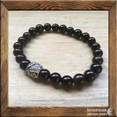 Black Obsidian offers release from tension and enables one to move forward in his/her life, with a more promising outlook.  PROBLEM SOLVE: Black Obsidian Yoga Mala Bracelet