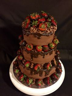 Tiered chocolate cake with chocolate covered strawberries