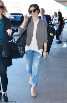 Casual cool: The brunette was spotted in slouchy jeans and a grey jacket when she arrived to LAX on Sunday
